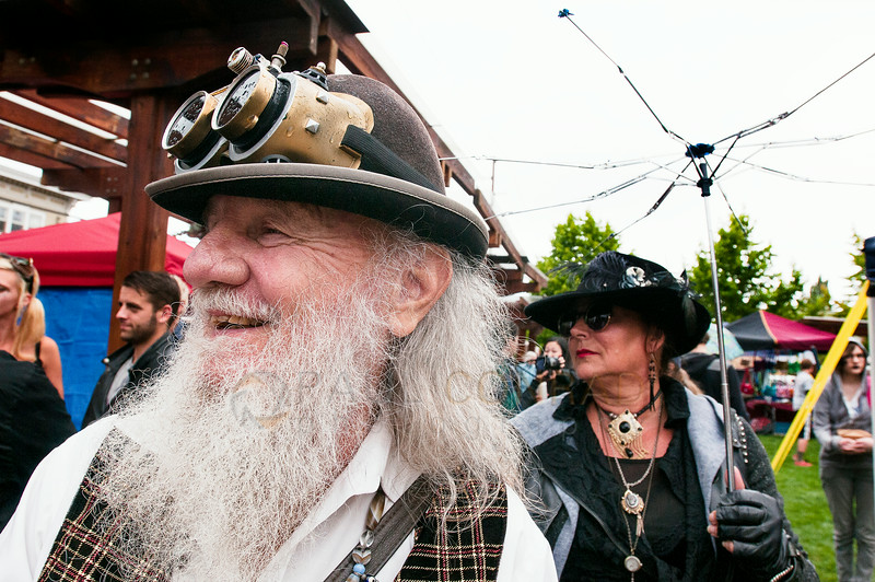 "© Paul Conrad/The Bellingham Herald - Jim ""Dirty Dan"" Rich, left, and Valerie Snelling during the Fairhaven Steampunk Festival at Fairhaven Village Green in Fairhaven, Wash.,  on Saturday afternoon July 19, 2014. Hundreds enjoyed the sights of individuals dressed in Steampunk Victorian costumes, live entertainment, food and vendors ."