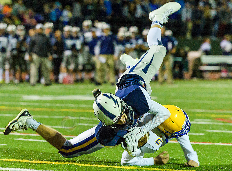 Squalicum wide receiver Noah Westerhoff (7) dives for the goal over Ferndale defensive back Sky Freeman late in the first quarter on Saturday evening Oct. 10, 2015, at Civic Field in Bellingham, Wash. Westerhoff failed to make the touchdown as time in the first quarter ran out. Squalicum failed to capitalize on their position losing the ball on downs during the first minute of the second quarter. © Paul Conrad/The Bellingham Herald -