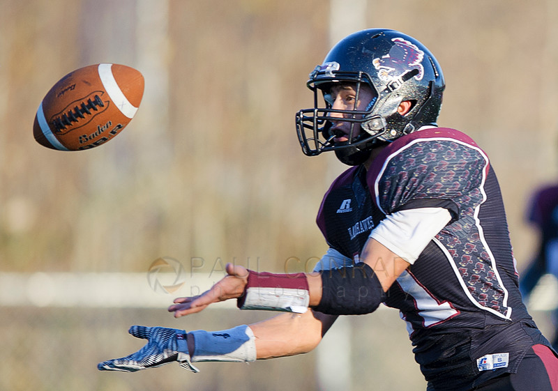 Lummi's Free Borsey (11) reaches for the ball to make an interception against Quilcene during the third quarter in the 1B state quarterfinals on Saturday afternoon Nov. 21, 2015, at Lummi Nation School in Lummi, Wash. Borsey returned the interception for 60 yards. The interception was called good but was called back due to a Lummi penalty. Lummi went on to defeat Quilcene 40 to 0 to advance to the semi-final. (© Paul Conrad/The Bellingham Herald)
