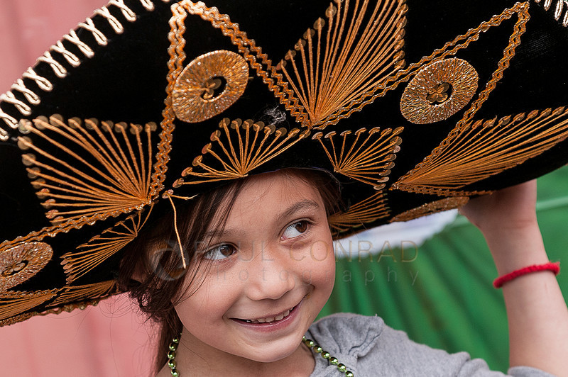 © Paul Conrad/ Pablo Conrad Photography - A party goer sports a sombrero during Xindi's birthday party on Saturday afternoon May 3, 2014.