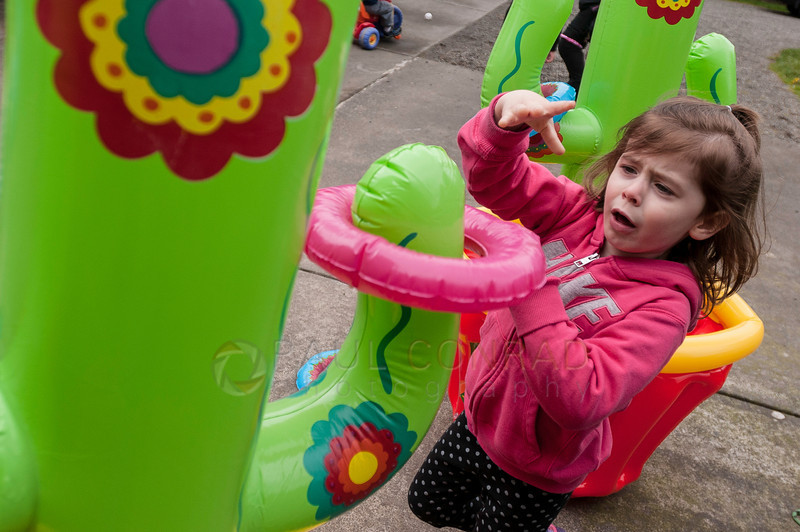 © Paul Conrad/ Pablo Conrad Photography - Kids try their luck playing ring toss during Xindi's birthday party on Saturday afternoon May 3, 2014.