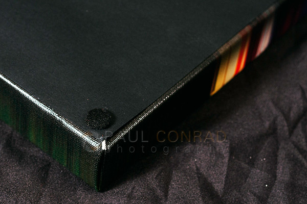 © Paul Conrad - The back of a Bay Photo canvas prints showing the tight corners, black cover, and felt tabs.