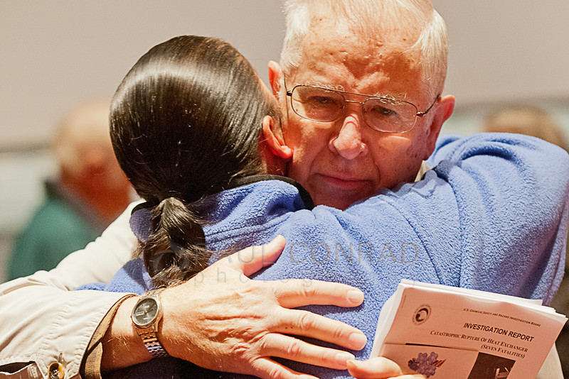 © Paul Conrad/San Antonio Express-News - Ken Powell  of  Mount Vernon, Wash.,  is hugged by Marie Howling Wolf (cq) during the public hearing and official release of the U.S Chemical Safety and Hazard Investigation report on Thursday evening Jan. 30, 2014, at Anacortes High School in Anacortes, Wash.  Powell's daughter Katheryn Powell, 28, of Burlington, is one of seven workers killed in an explosion at the Tesoro Refinery in Anacortes in the early hours of April 2, 2010.
