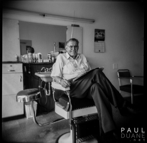holga black and white photograph of old barber