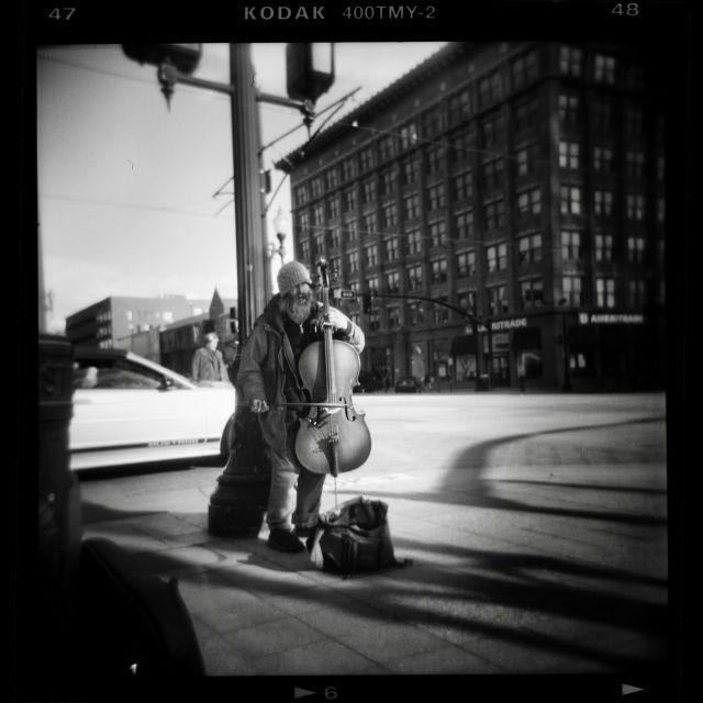 Elliot Street cellist. Holga film street photography Salt Lake City