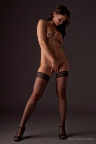 nude model in thigh high stockings and heels