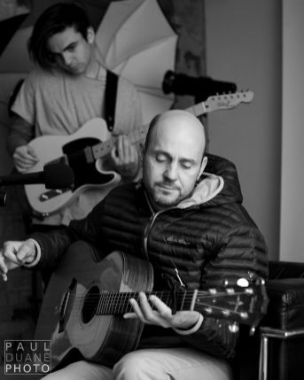 Singer / songwriter Peter Breinholt performs with his son Nathan during a taping of The Paul Duane Show podcast.