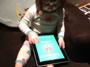 A 2.5 Year-Old Has A First Encounter with An iPad
