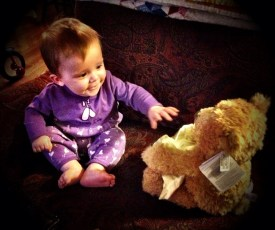 Lily playing with her new peek-a-boo bear