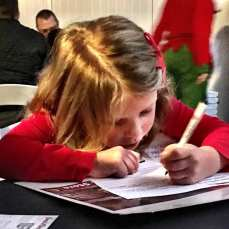 Lily writing her note to Santa... Very focused...