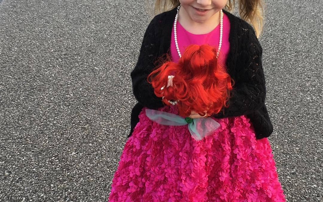 Lily taking her mermaid doll to church
