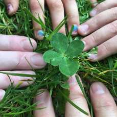 Out in the yard with Kristen near her garden. All of us just found this together. #fourleafclover