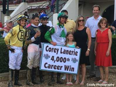 Corey Lanerie's family and fellow jockeys join him in the winner's circle to celebrate his 4,000th career win