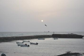 The sun sets over Masirah