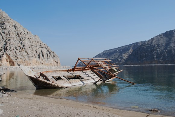 Abandoned dhow at low tide