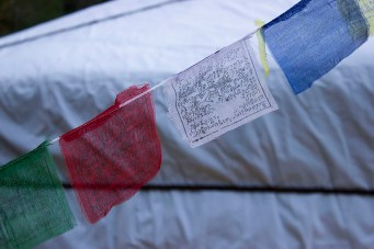 Nepalese prayer flags in front of an authentic Mongolian yurt.