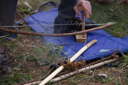 Bow-drill fire making, one of several primitive skills learned over the semester.