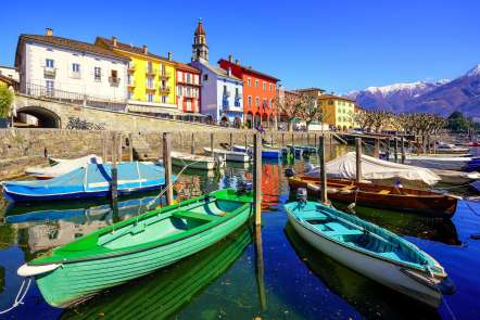Colorful boats in old town of Ascona on Lago Maggiore lake in the Alps mountain, Ticino, Switzerland