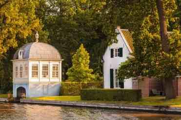 Old historic boathouse alongside the Dutch Vecht river