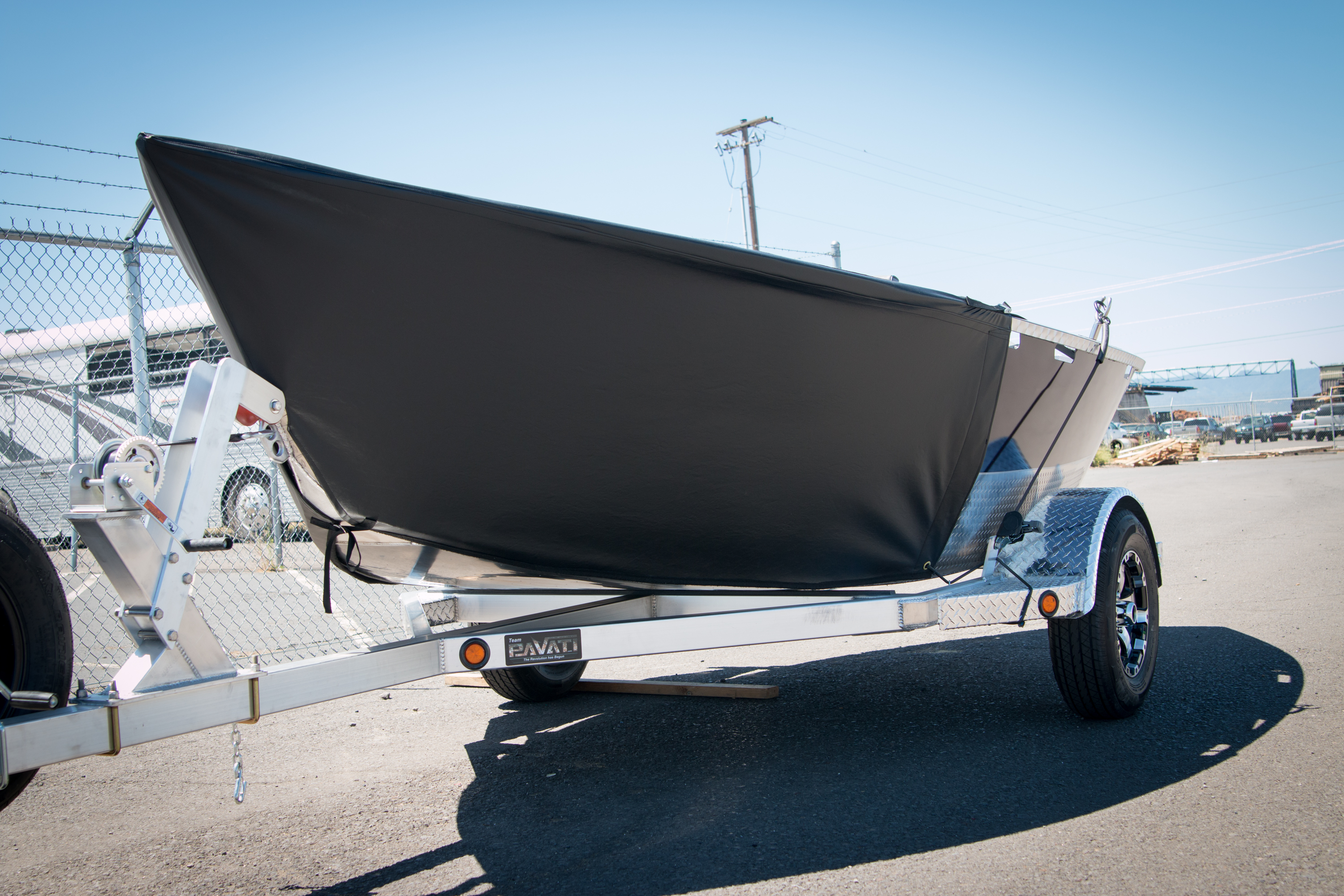 Black-Blue Pavati Marine Drift Boat with Diamond Plating Loaded Up Onto the Trailer