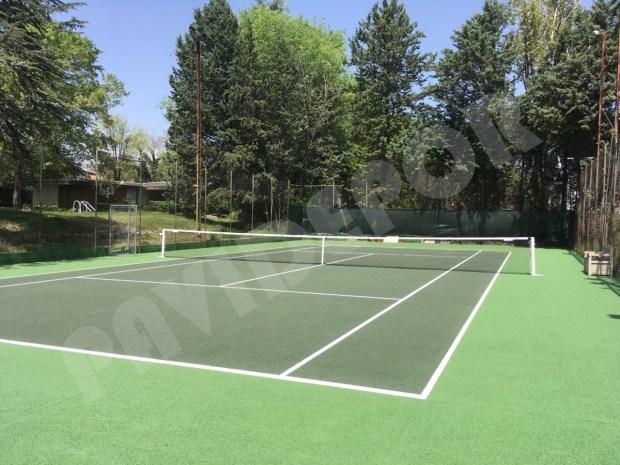 Reparacion pista de tenis despues