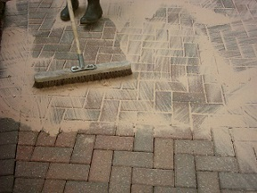 Once the sunken paving has been compacted apply kiln dried sand to the block paving to lock the pavers together
