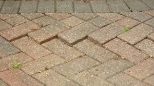 Lift and relay block paving that is sinking or has moved sideways