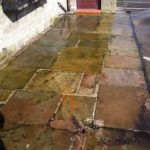 Wet the patio paving slabs with water and sweep away loose dirt