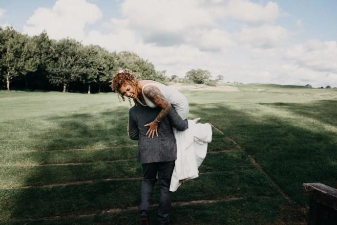 bride and groom on castle dargan golf filed