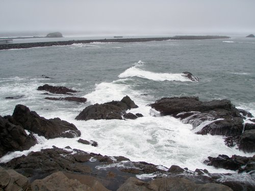 waves crashing against the bluff the lighthouse was on