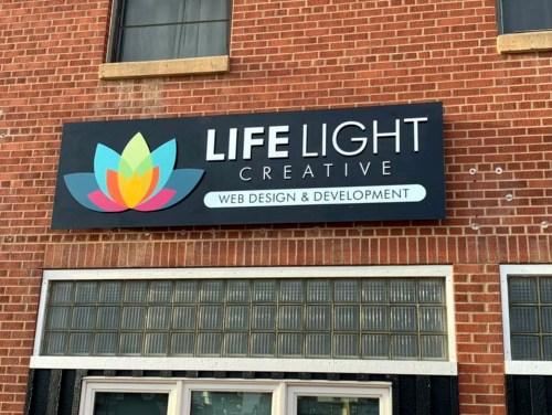 life light creative storefront sign