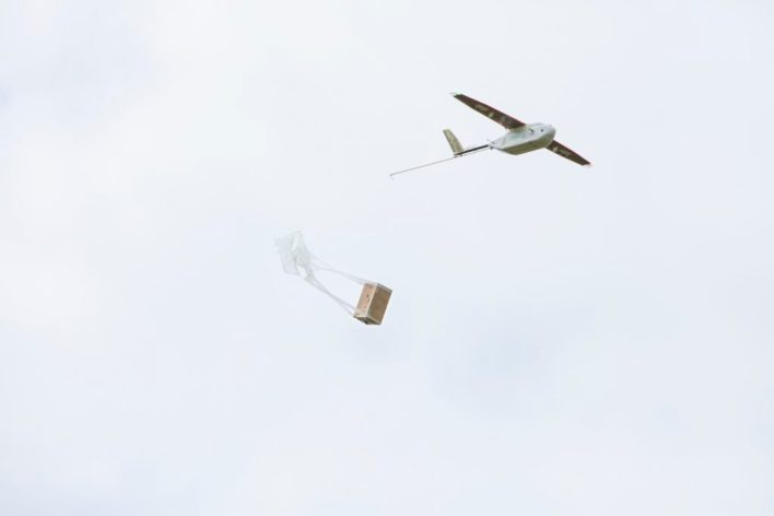 The Zipline drone dropping the parcel at the destination during a simulation