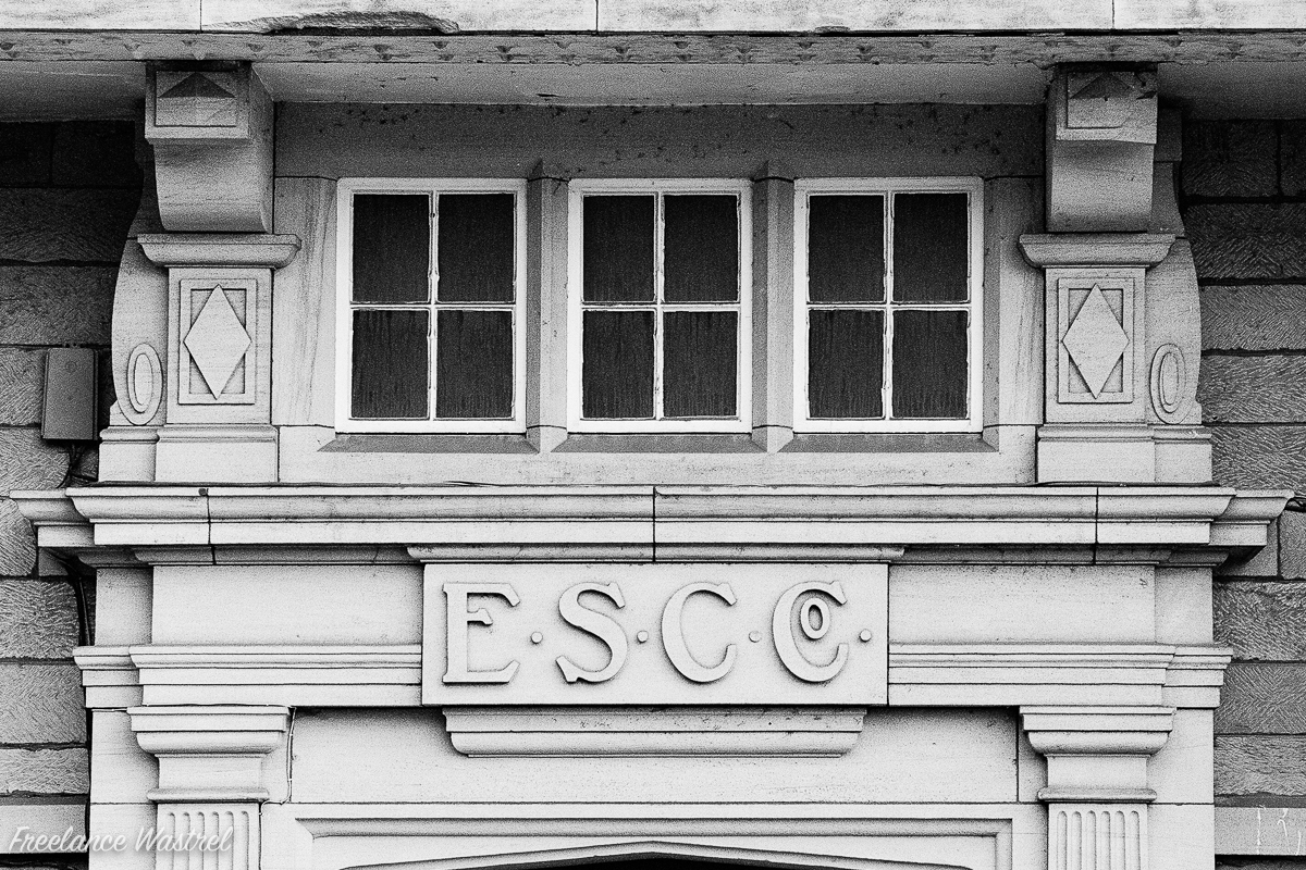 E.S.C.Co. carved stone lettering