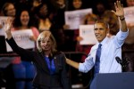 Democratic challenger for Wisconsin Governor, Mary Burke, and U.S. President Barack Obama wave to supporters at a campaign rally at North Devision High School in Milwaukee. Photo by Darren Hauck/Getty Images