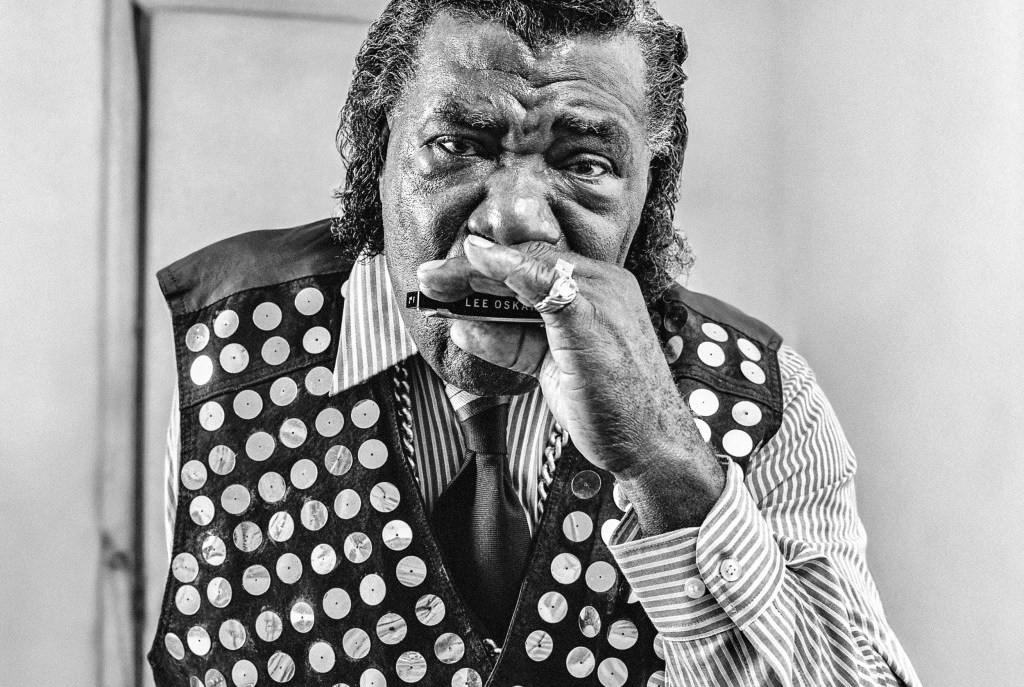 """Neal Pattman, Athens, Georgia, 1995. """"Neal loved his blues and would sing and play his hard anywhere. I always got a kick when he broke into a gospel song every time we were about to take off on a plane."""" Photo courtesy Tim and Denise Duffy"""