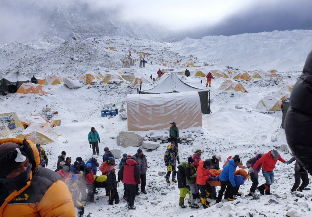 rescuers on april 26 use stretchers to carry the injured at everest