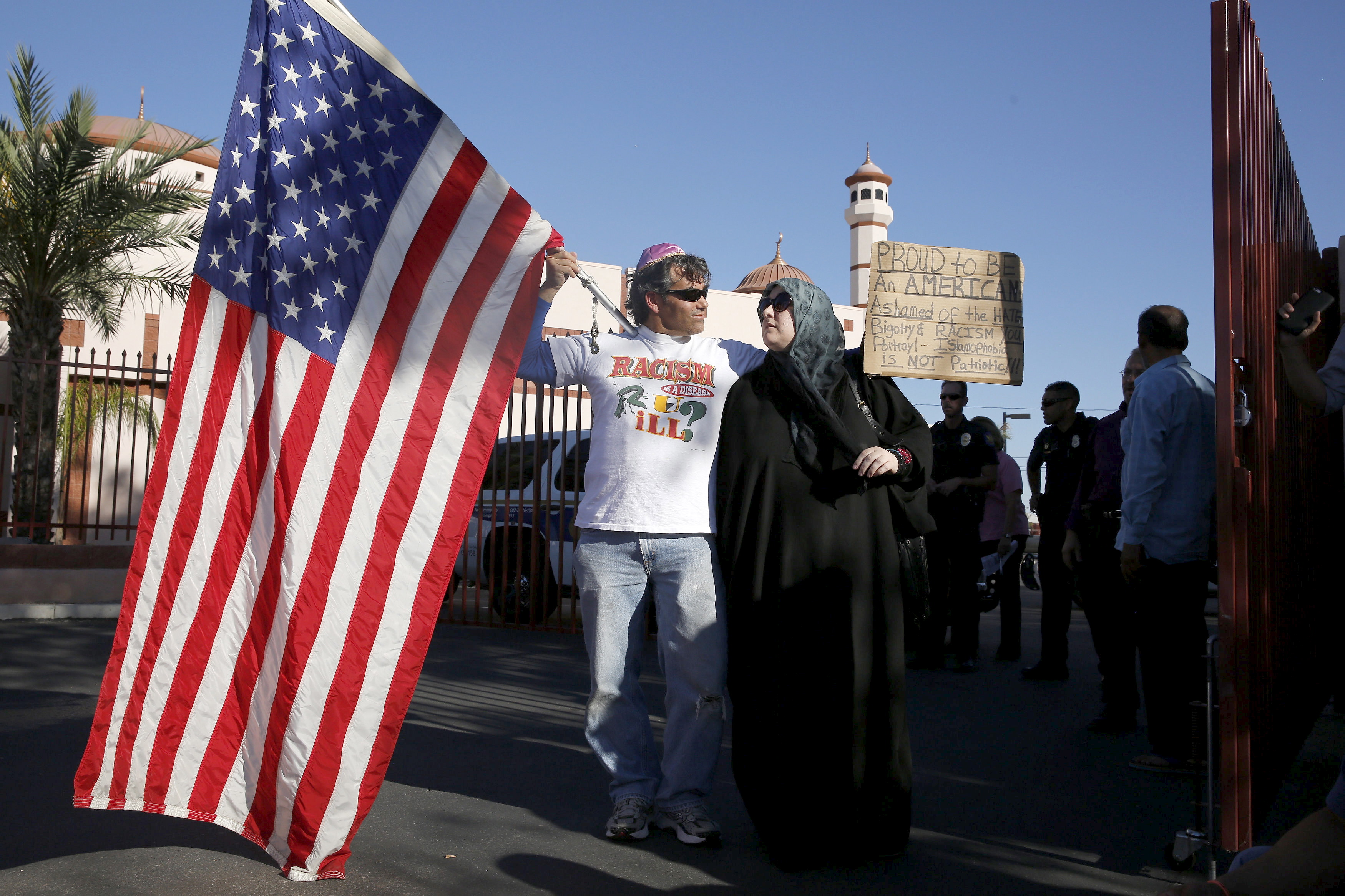 "Two demonstrators stand in front of the Islamic Community Center to oppose the ""Freedom of Speech Rally Round II"" across the street in Phoenix, Arizona May 29, 2015. Photo by Nancy Wiechec/Reuters."