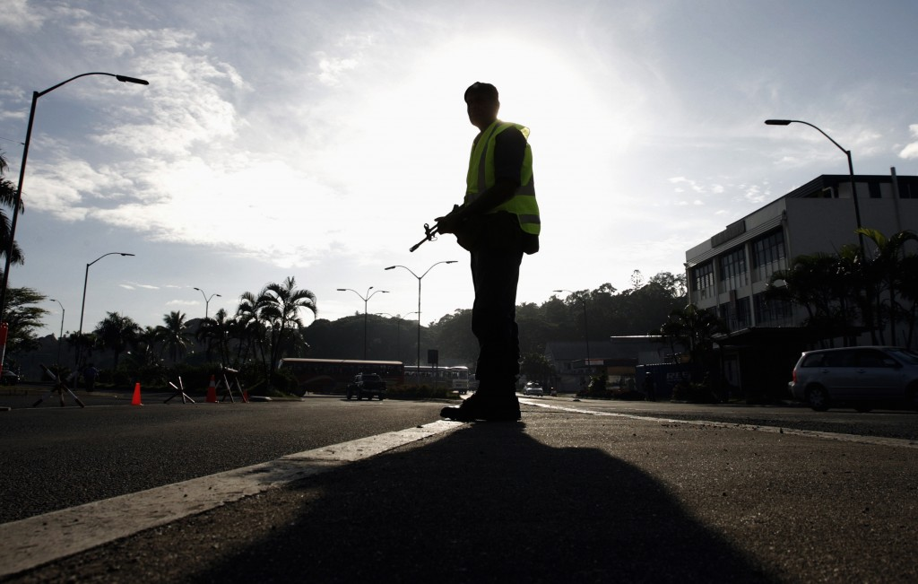 A 2006 photo shows a Fijian sailor at a check point on a road leading into the nation's capital Suva. Photo by Tim Wimborne/Reuters
