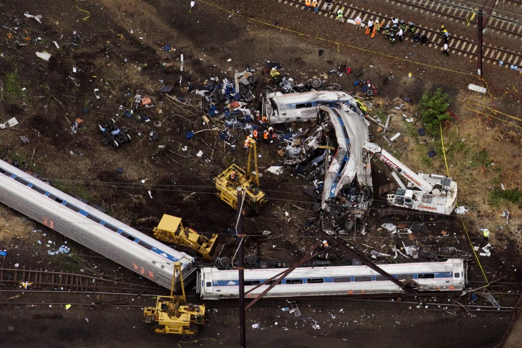 Rescue workers sift through twisted metal and debris from Amtrak train 188 that derailed in Philadelphia Tuesday. Photo by Lucas Jackson/Reuters
