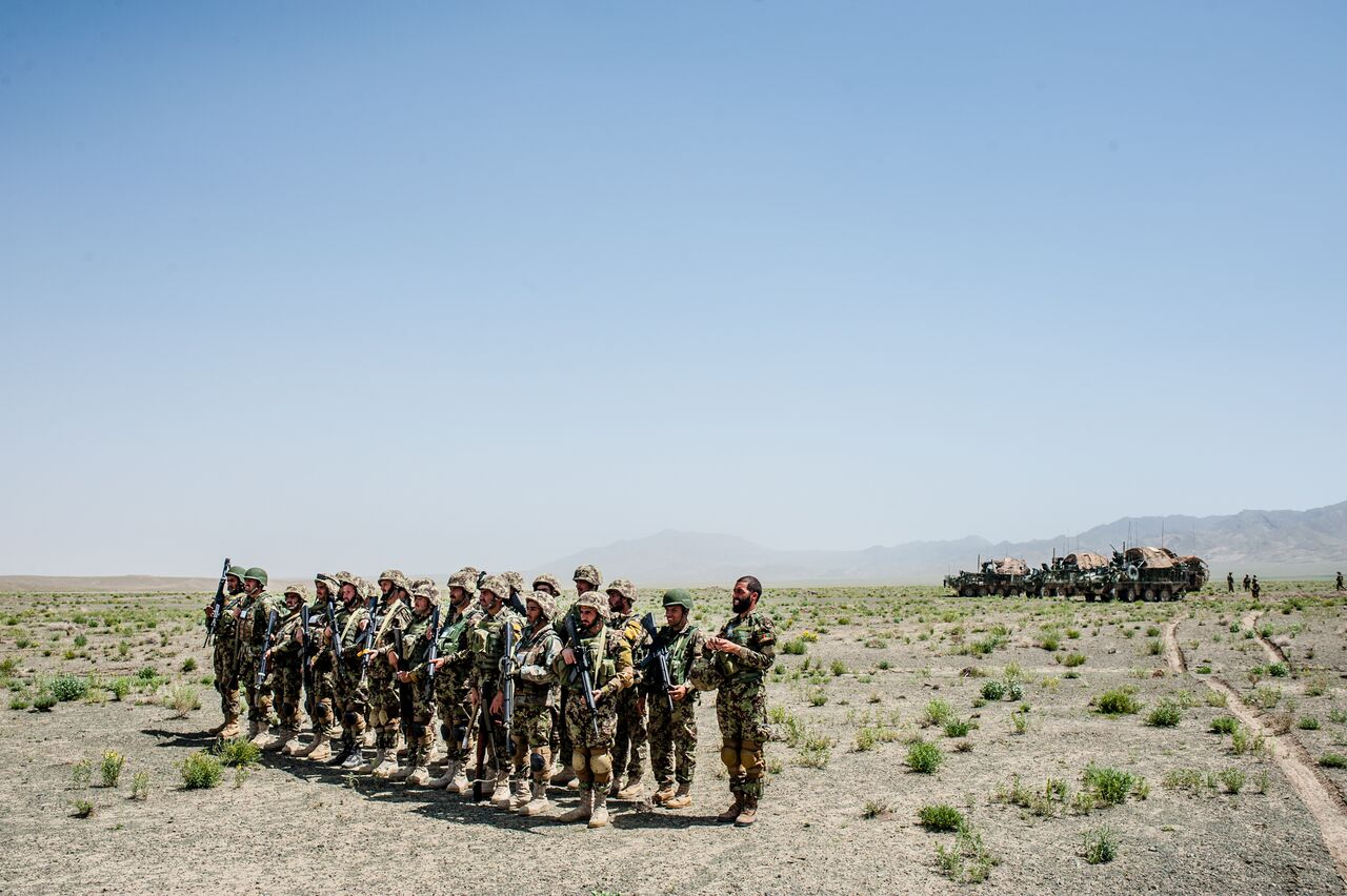 Afghan soldiers stand in formation as they wait for their commander before conducting patrols in Zabul using American-made armored vehicles. Photo by Ben Brody/The GroundTruth Project