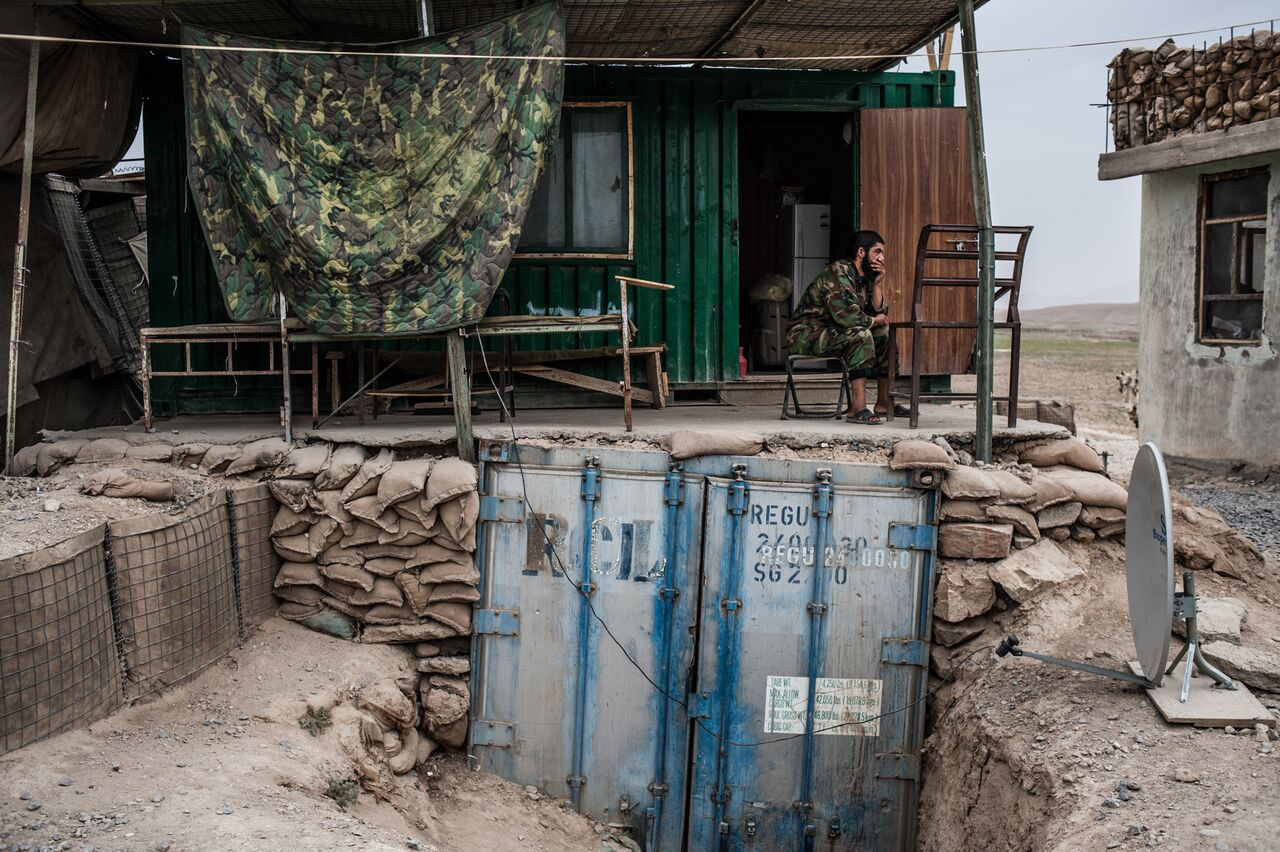 An Afghan soldier rests after guard duty in Zabul Province. Afghan and Romanian soldiers are stationed at checkpoints along a highway in Zabul that winds through Taliban-controlled mountains. Photo by Ben Brody/The GroundTruth Project