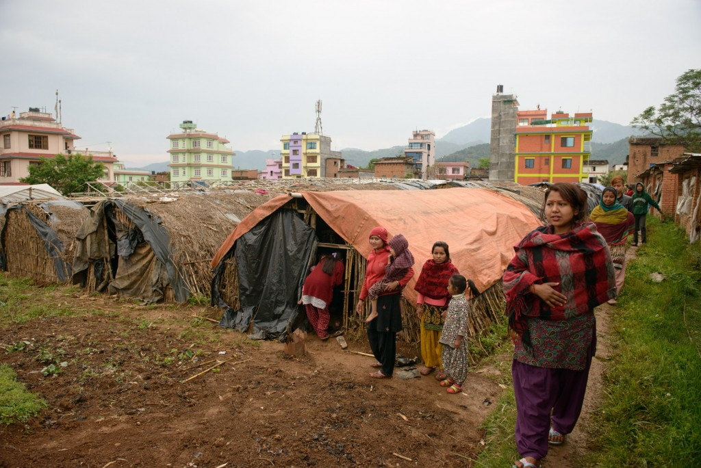 People affected by the April 25 earthquake in central Nepal are sleeping in tents near a mushroom farm in Chapagaon. Photo by Miguel Samper for Mercy Corps