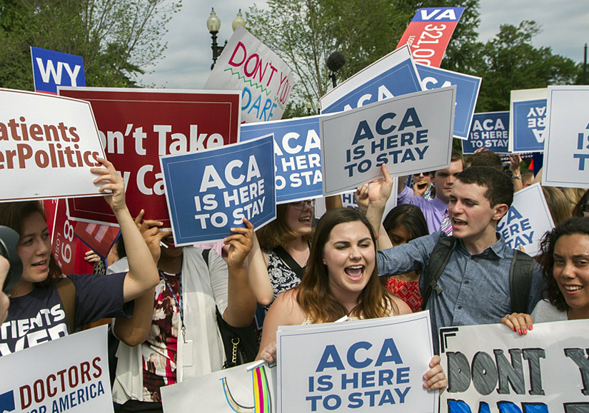 Supporters of the Affordable Care Act gather outside the Supreme Court shortly after the court announced it would uphold the ACA on June 25, 2015.  Photo by Corinne Segal