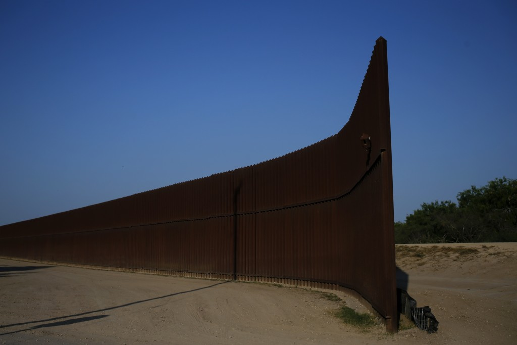 A break in the border fence at the United States-Mexico border is seen outside of Brownsville, Texas, August 5, 2014. On the 25th anniversary of the fall of the Berlin Wall, there are still barriers separating communities around the world, from the barbed wire fence dividing the two Koreas, the fence around the Spanish enclave of Melilla, to the sectarian Peace Wall in Belfast, the Israel-Gaza barrier and the border separating Mexico from the United States. REUTERS/Shannon Stapleton