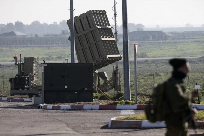 An Israeli soldier guards an Iron Dome rocket interceptor battery deployed in the Israeli-occupied Golan Heights January 21, 2015. Photo by Baz Ratner/Reuters