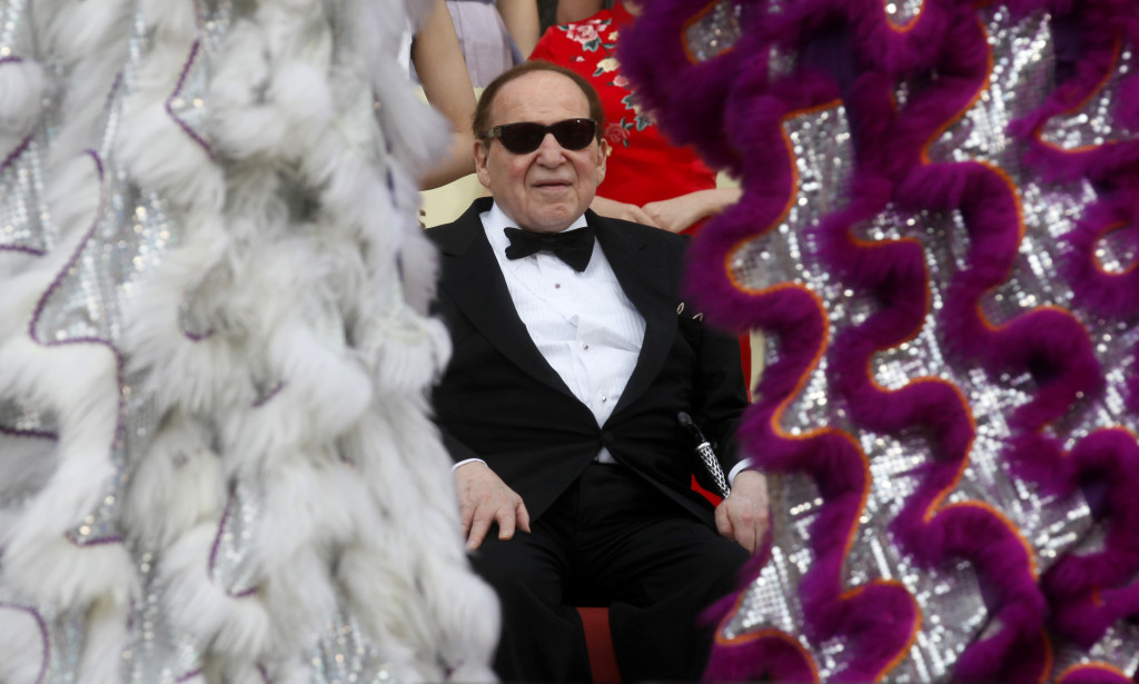 Las Vegas Sands Chairman and CEO Sheldon Adelson watches a lion dance at the opening ceremony of the Sands Cotai Central in Macau Wednesday, April 12, 2012. Adelson's Macau casino operator launched its long-delayed fourth resort, a $4.4 billion complex that is its latest bet on continued strong growth in the world's biggest gambling market.