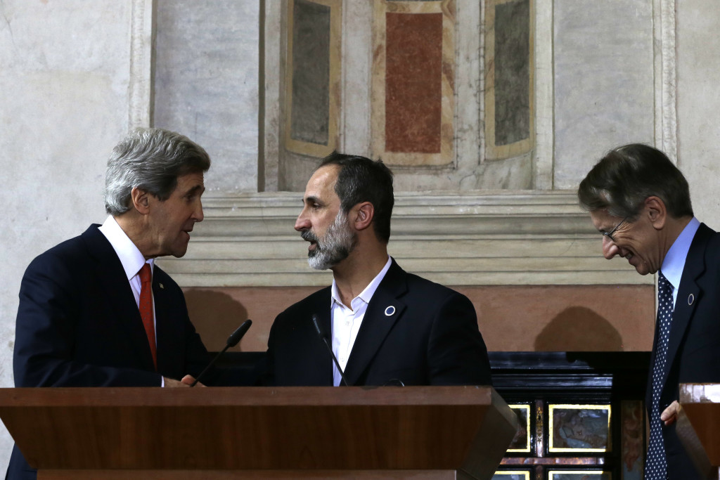 U.S. Secretary of State John Kerry, left, shakes hands with Syrian National Coalition President Mouaz al-Khatib, after he spoke at a news conference along with Italian Foreign Minister Giulio Terzi after meetings at Villa Madama in Rome on Thursday, Feb. 28, 2013. Rome is the fourth leg of Kerry's first official overseas trip, a hectic nine-day dash through Europe and the Middle East. (AP Photo/Jacquelyn Martin, Pool)
