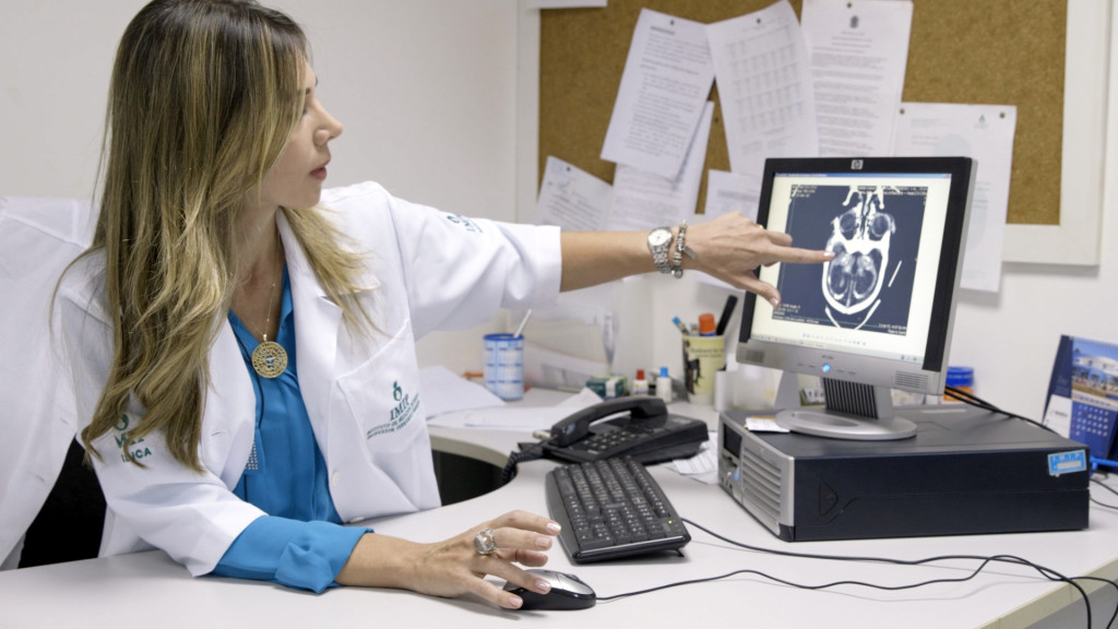 Dr. Adriana Scavuzzi, the women's health coordinator at IMIP hospital in Recife, Brazil, points to calcium deposits in the brain scan of a microcephaly patient.