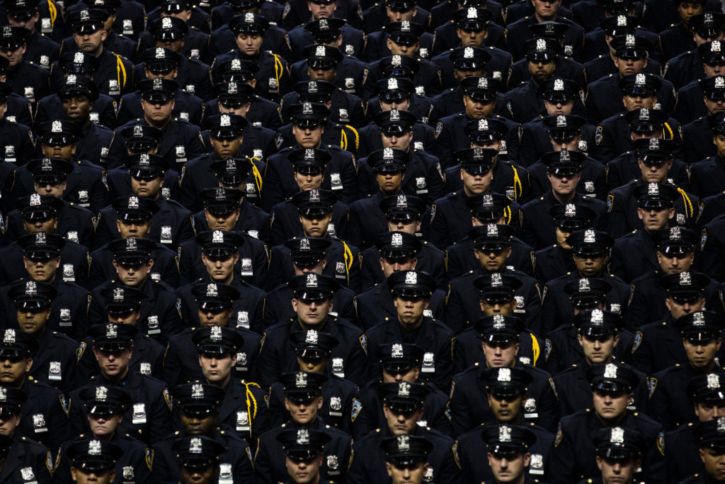 New York City Police Academy cadets attend their graduation ceremony on July 2, 2013 in Brooklyn.