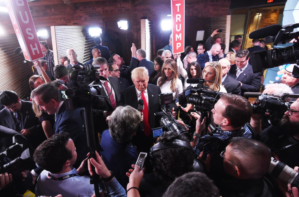 """GOP presidential candidate Donald Trump speaks to the media in the """"spin room"""" after a debate in South Carolina."""